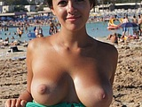 Cute Girl Flashing Topless Her Big Boobs on Public Beach Photo