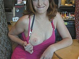 Sexy Redhead Flashes Tits in Public Place - Voyeur Pictures