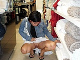 Flashing Her Cunt in a Public Store - Voyeur Pictures