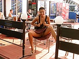 Girl Flashing Pussy at a Table in Public - Voyeur Pictures