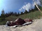 Black Girl Naked and Oiled at the Beach