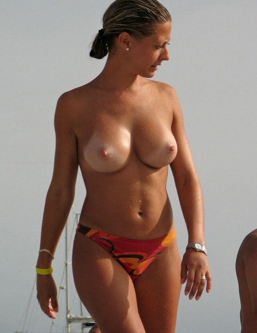 Big Titties On The Beach Sexy Photo