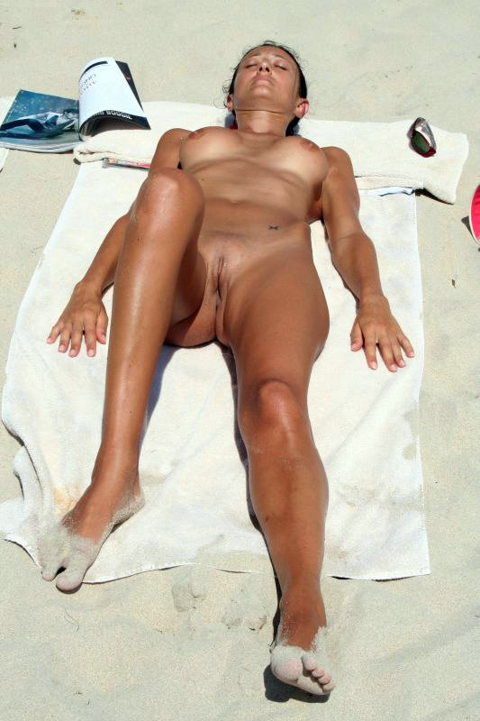 Hot Woman Nude Sunbathing on the Beach Pictures