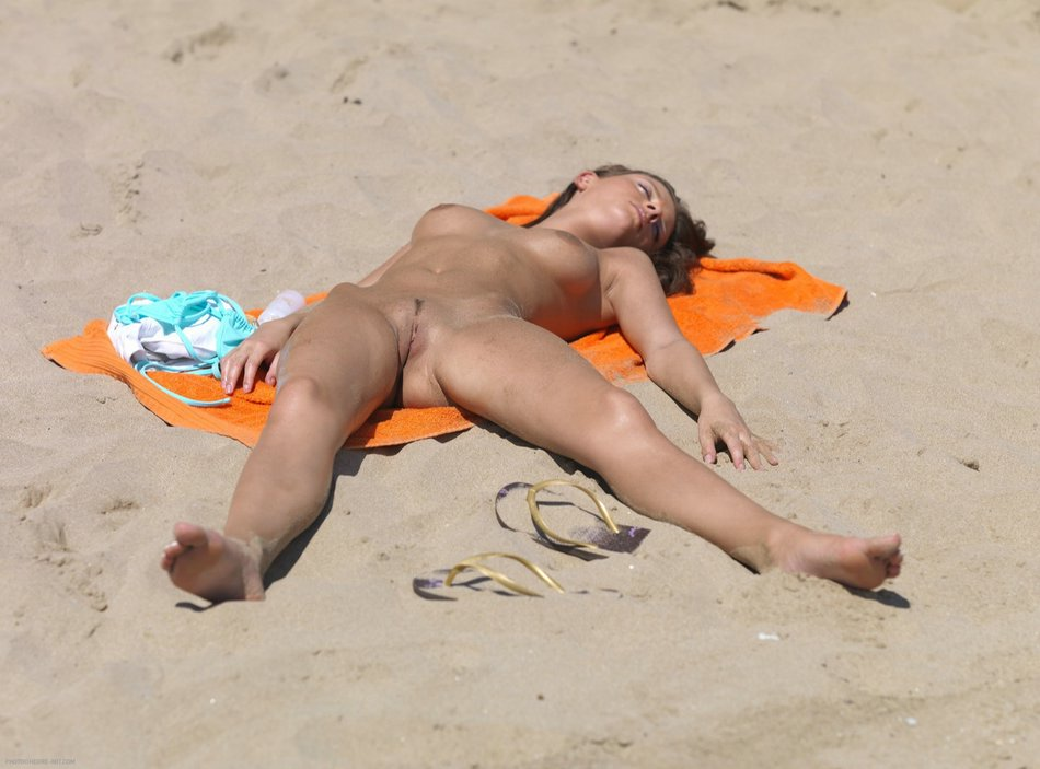 Nude girls on beach sunbathing