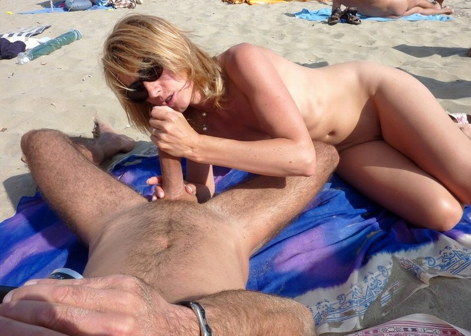 Old nudist having sex on beach