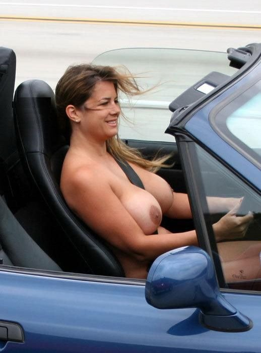 Sexy Busty Woman Flashing Her Big Boobs in Car Nude Photo
