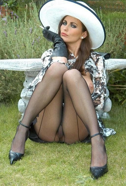 Sexy woman posing upskirt with her hot legs and pantyhose