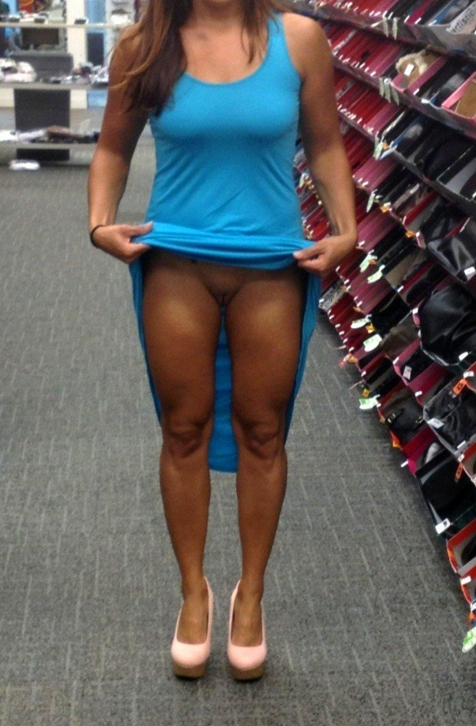 Flashing Her Shaved Pussy in Public Store
