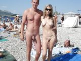 Nudist Couple Posing for the Photo Camera at Beach