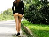 Hot Woman Flashes Nude Ass on Road in Public Nudity Photo