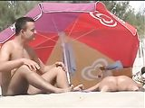 Hot Brunette Woman with Big Tits Filmed Naked at the Beach