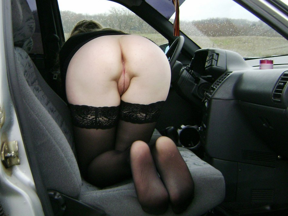 Nude girl in backseat of car Tell