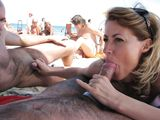 Wife at Nudists Beach Gives Oral Sex and Handjob to Two Men - Voyeur Pictures