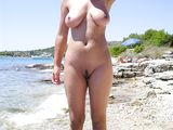Wife completely naked at the beach - Voyeur Pictures
