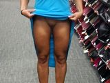 Flashing Her Shaved Pussy in Public Store - Voyeur Pictures